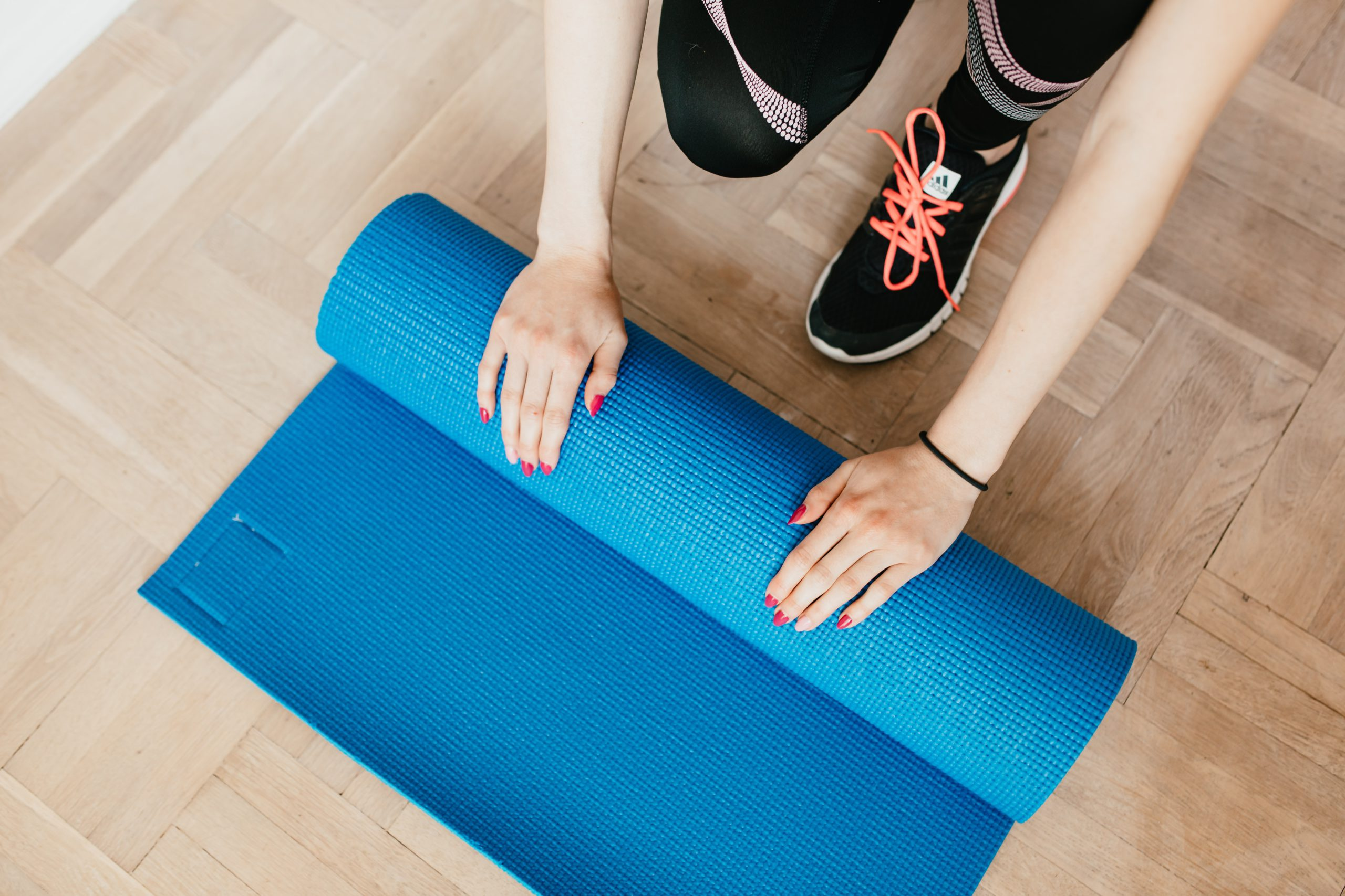 Girl rolling yoga mat